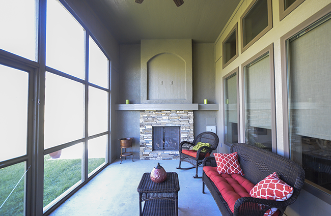 Covered Patio with Outdoor Fireplace in New Custom Home